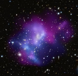 618px-Cosmic_Heavyweights_in_Free-For-All-_One_of_the_most_complex_galaxy_clusters,_located_about_5.4_billion_light_years_from_Earth.